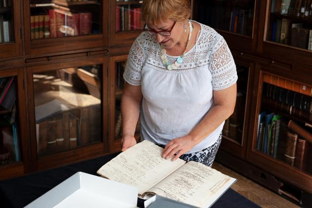 Archivist Susan Snell with William Perfect Manuscript, 2019 ©Museum of Freemasonry